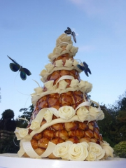 £795 Croquembouche with Spiral of chocolate roses and butterflies