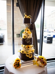 £950 Five tier chocolate wedding cake with sunflowers