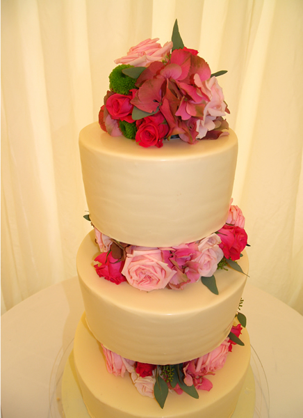 £695 Clean Lines and Flowers Chocolate wedding cake