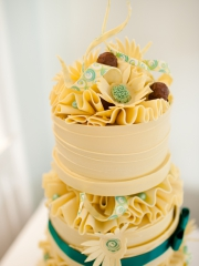 £725 White Wraps and ruffle chocolate wedding cake
