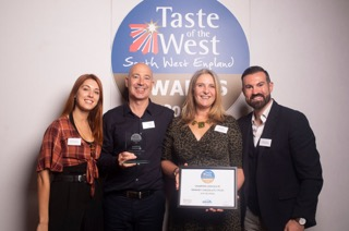 Lick the Spoon collecting the Champion Chocolate Award